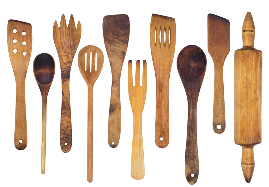 A photo of several wooden spoons, spatulas, and a rolling pin.