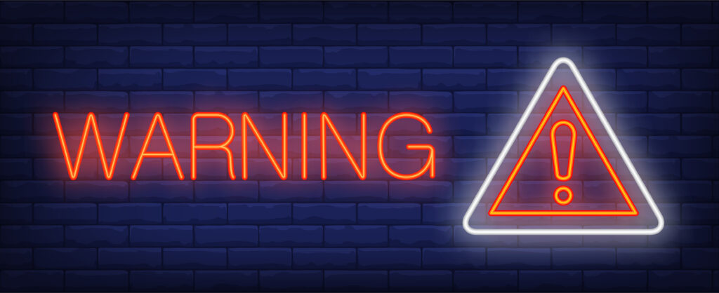 """""""Warning"""" in neon with a danger sign"""