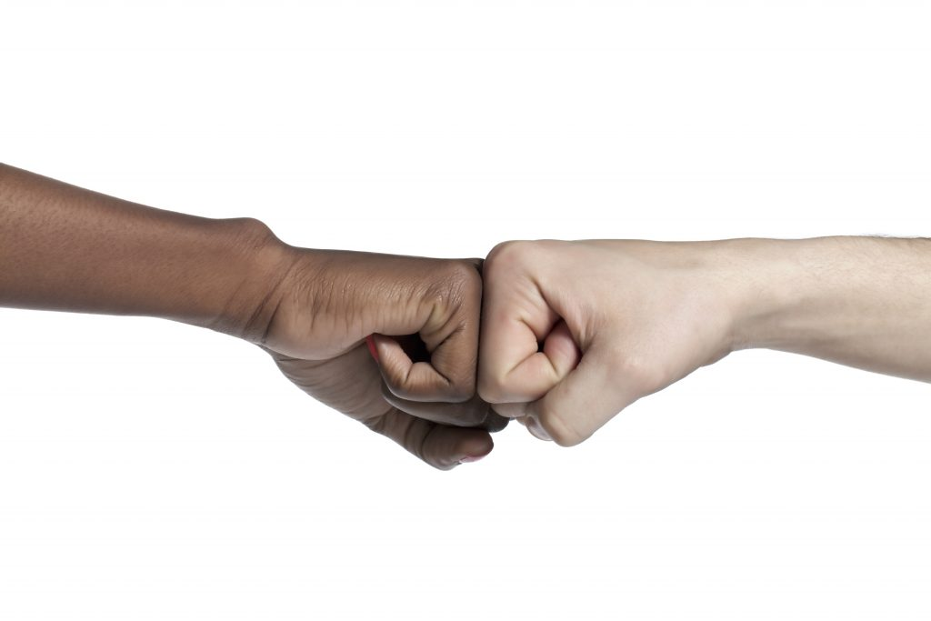 Two fists in a fist bump