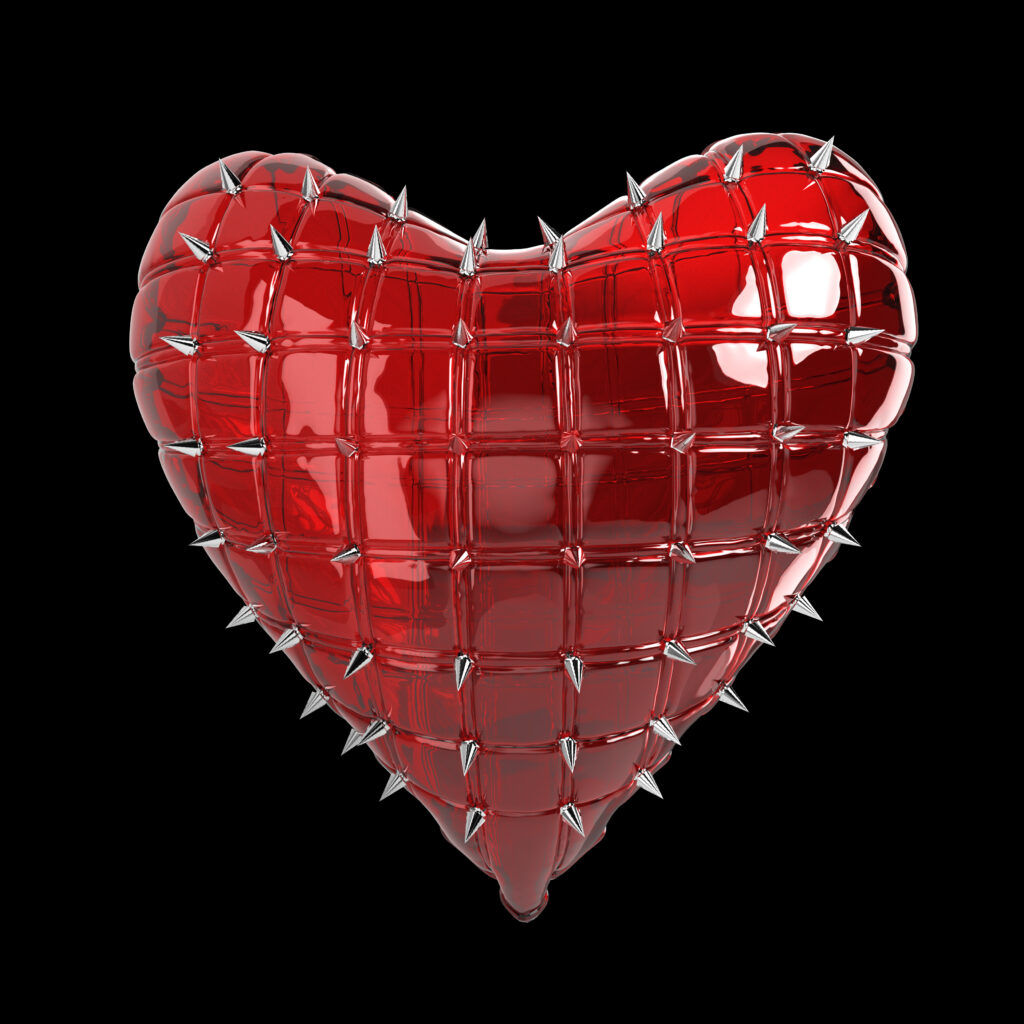 Red heart-shaped balloon with silver spikes sticking out of it