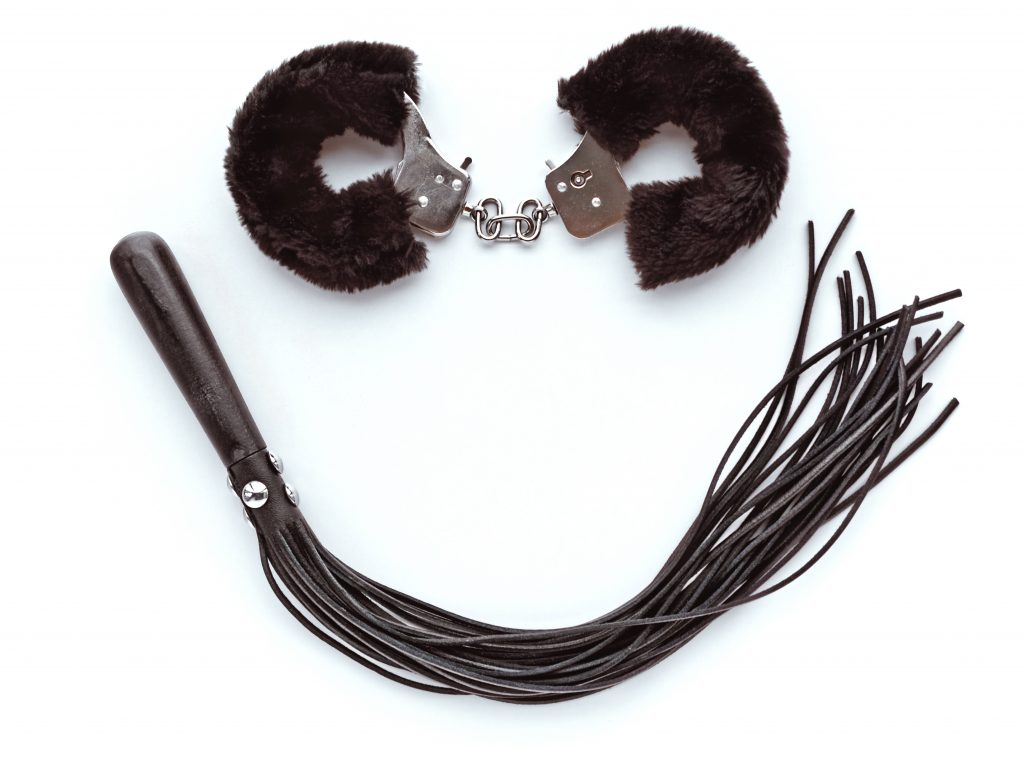 fuzzy handcuffs and flogger